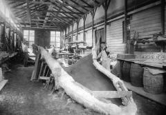 Workers in a shed preparing the cast of the blue whale