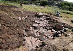 The excavation site of an Inuit home in Hare Harbor, Quebec, Canada
