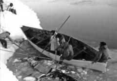 eskimos land a skin boat in the ice