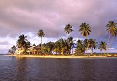The sun sets over the Smithsonian's marine field station at Carrie Bow Cay, Belize. For more than three decades, it has been home to the Smithsonian's Caribbean Coral Reef Ecosystem Program.