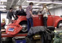 Students studying climate change create an electric car.