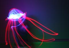 a light painted image of a red and white squid