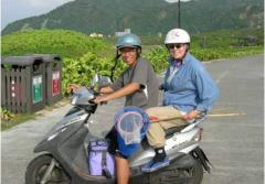 Curator and Research Scientist Lynne Parenti with student Shao-i Wang on a moped with fish collection gear