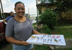 Jeweler Palovi Baezar with her first set of lionfish earrings, which she made in the summer of 2013.