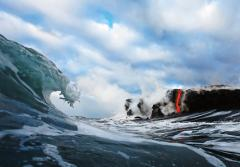 """In 2010, I became the first photographic artist to ever photograph lava from inside the surf. I waited five years for the conditions to be perfect for this type of shot. First, the lava had to cross the beach where most of the coast is a rugged cliff. T"