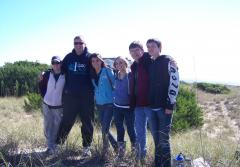 North Carolina Delegation students and teachers posing for a photo in front of the ocean at Bald Head Island in North Carolina