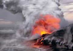 """In the upper left of this image I can visualize the profile of Pele, the fire goddess of Hawaiian folklore, as if she is whispering to the sea."" -- Nature's Best photographer, Peter Lik.