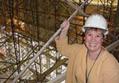 Elizabeth Munsteen wears a hardhat in the Ocean Hall while under construction.