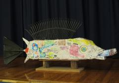 A four-foot long fish sculpture has fins and tail made with recycled rakes.