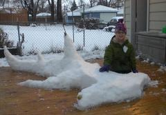Sophi Bromenshenkel poses with a hammerhead shark snow sculpture.