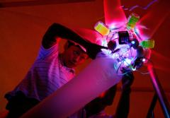 Artist Shih Chieh Huang's creations are often composed of lights, computer parts, and plastic refuse.