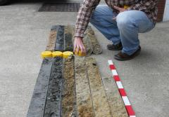 An archaeologist arranges a deep-sea core.