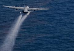 A jet drops dispersant onto the Gulf oil slick.
