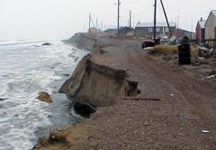 A stormy sea lashes the village of Shismaref, Alaska, where the coastline has eroded 30–90 m (100–300 ft) in the past 30 years.
