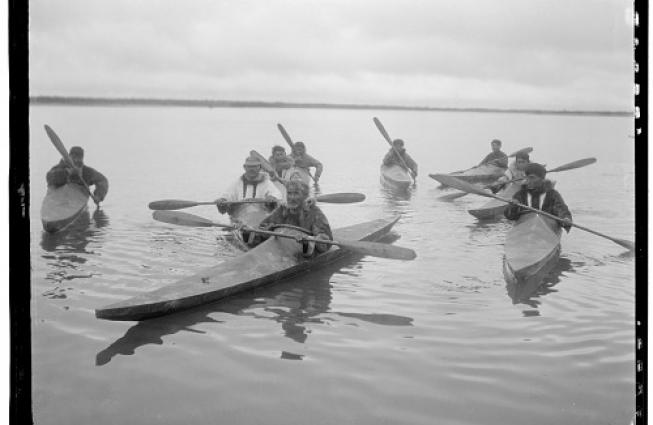 a group of men in kayaks