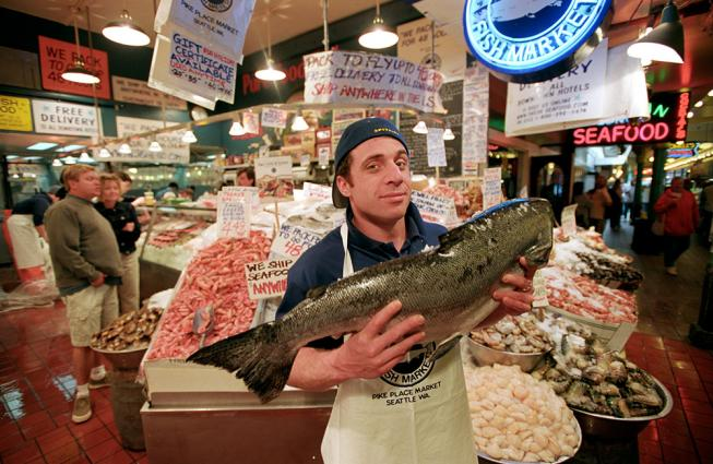 David Barouh displays fresh fish for sale at Seattle's Pike Place Market